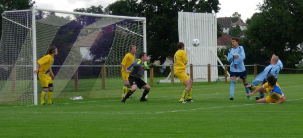 Aaron Day forces the ball home