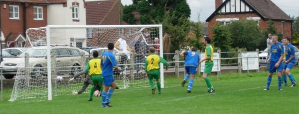 Richard James wheels away after opening the scoring for Harwicke against Berkeley Town