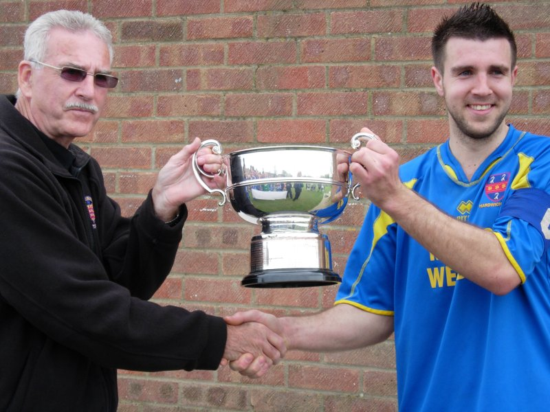 Hardwicke captain Ben Wood, accepts the trophy from league Chairman Bob Stewart