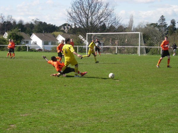 Ken Malala gets a tackle in for Henbury