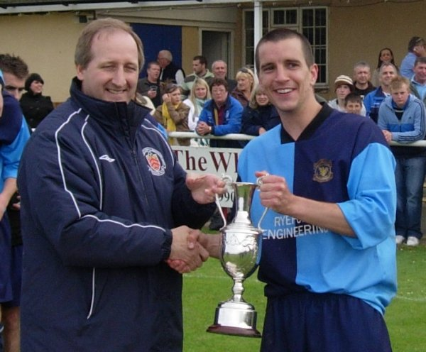 Kings Stanley captain Martin McDermott receives the Trophy from GFA Chief Executive David Neale
