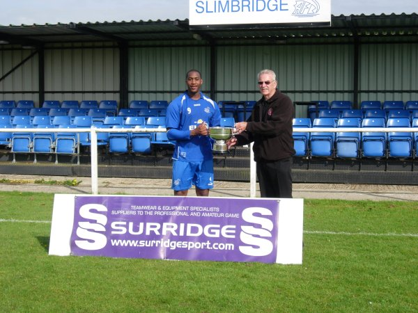 Slimbridge Captain Marvyn Roberts accepts the Trophy from League Chairman Robin Stewart