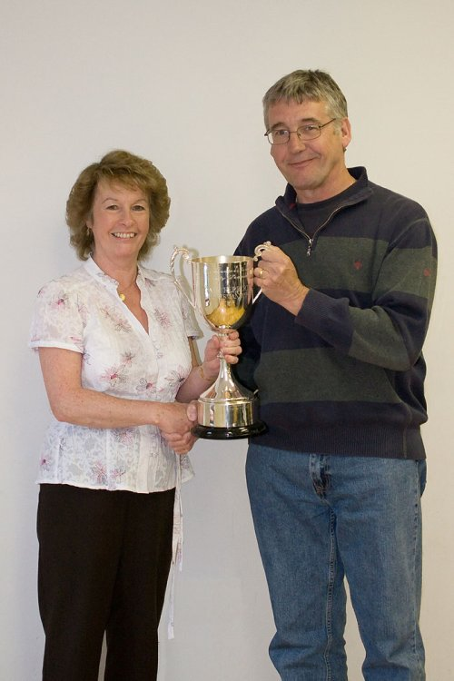 Wotton Rovers secretary Steve Tasker receiving the Dave Herbert Sportsmanship Cup from Gill Herbert