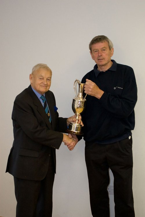 Hardwicke secretary Stan Hine receiving the Les James League Cup from Vice-President John Crowther