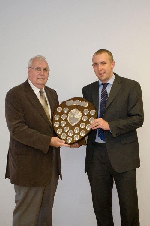 Rob Cockle receiving the Tony Neather Shielf from GFA Referees Committee Chairman Alan Pearce