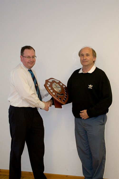 Kings Stanley secretary Roger Bassett receiving the Ron Jay Shield from Registration Secretary Nigel Meaney