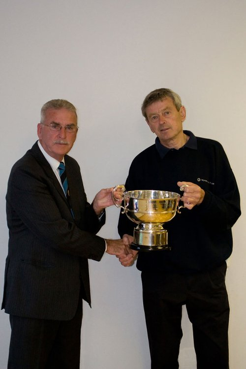 Hardwicke secretary Stan Hine receiving the League Championship Trophy from Chairman Robin Stewart