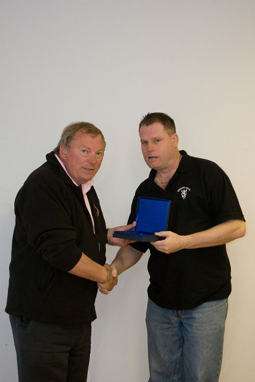Highridge United secretary Lee Watts receiving the League Runners-up award from Vice-Chairman Peter Langley