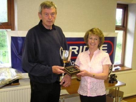 Hardwicke secretary Stan Hine receiving the Dave Herbert Sportsmanship Trophy from Jill Herbert