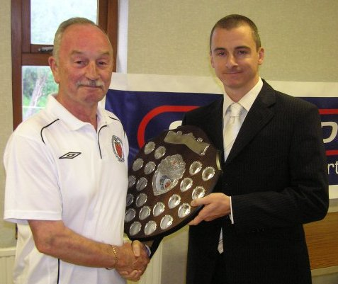 Mark Russell receives the Tony Neather Shield from Ken Fry.