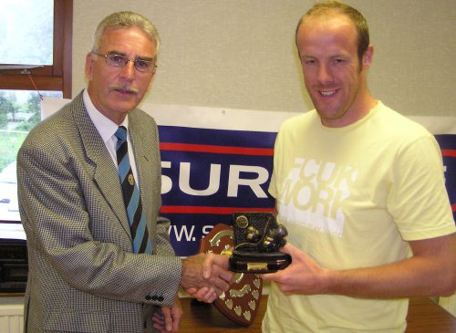 Nathan Baird receives the Leading Goalscorer Trophy from Robin Stewart.