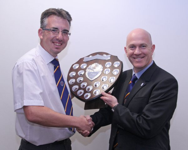 Steve Oakey on the right being presented with the Tony Neather Shield for the Top Marked Referee throughout the season by Referee Secretary Adrian Shilston