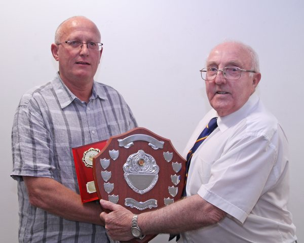 Charlie Barron of Henbury on the left is being presented with the Ron Jay Shield for the Most Efficient Club Secretary throughout the season by League Secretary Ron Holpin