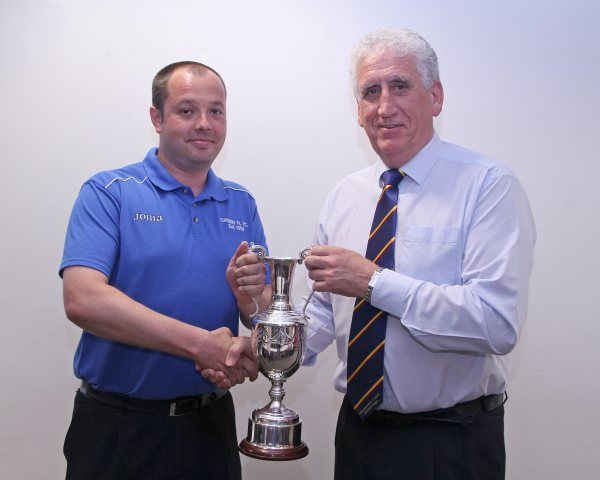 Dave Herbert Development Chairman presents the Les James League Cup to Simon Hartley Secretary of Cribbs Friends Life Football Club