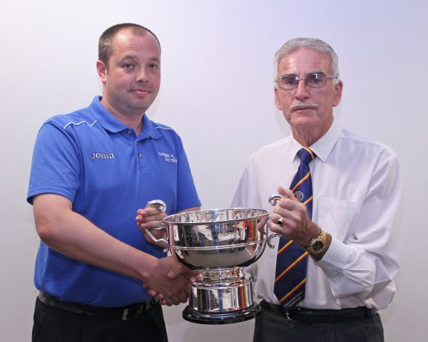 Bob Stewart League Chairman presents the Championship Cup to Simon Hartley Secretary of Cribbs Friends Life Football Club