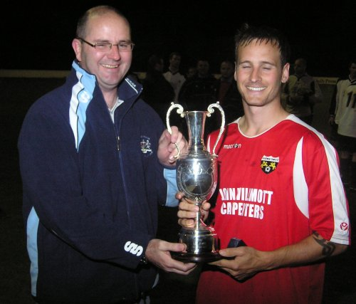 Patchway Town Captain Mark Palmer receives the Les James Trophy from Mel Wheeler.